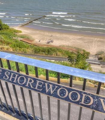 Shorewood Guardrail Sign with the Beach in the Background